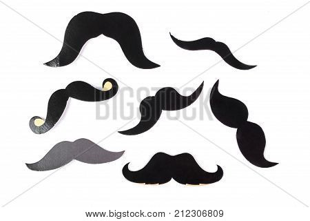 Set of fake moustaches on white background. Fake black mustache isolated on white background. Gentelman party concept.