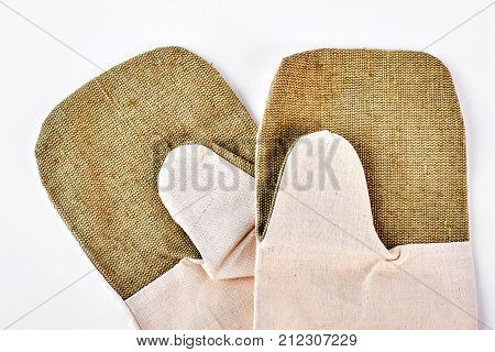 Pair of kitchen protective gloves. Pair of cotton oven gloves isolated on white background. Kitchen clothes, studio shot.