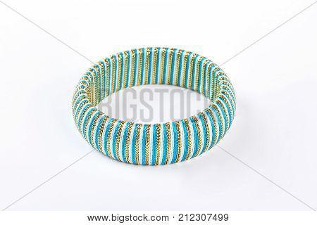 Fashion striped bracelet on white background. Luxury blue bracelet isolated on white background. Female modern accessory.