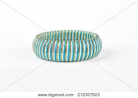 Fashion bracelet on white background. Female striped bangle on sale. Woman luxury accessory.
