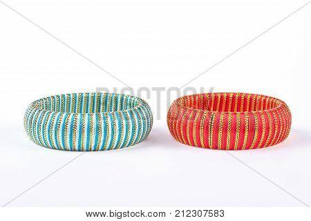 Fashion bangles on white background. Two elegant bracelets on white background. Woman stylish accessories.