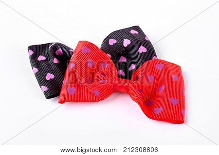 Two bow ties on white background. Girls fashion hair bows on white background. Kids hair accessory.