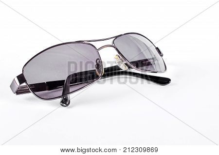 Man sunglasses with metal rim. Male vintage sunglasses with dark glass and metal frame, isolated on white background. Men square sunglasses.