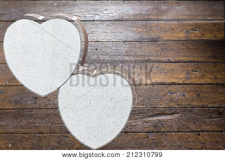 horizontal wooden plank background image with two blank hearts for copy and text great for valentines day