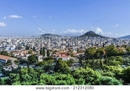 Panoramic view of the city of Athens from the hill of Philopappos in which Mount Lycabettus stands the tallest of Athens
