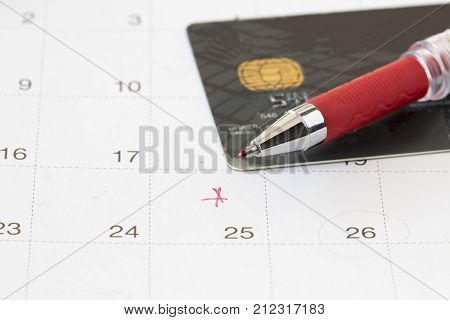 calendar with credit card for check payment to bank