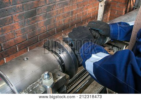 Fitter Working On On An Automatic Welding Machine