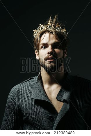 Man or cinderella prince in crown on grey background. Freak gay and transvestite. Drag queen homosexual and trans. Fashion jewelry accessory. Glory nobility triumph concept. poster