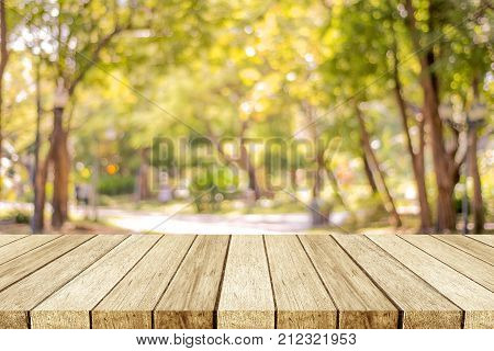 Blurred nature background Empty wooden table over blur nature park outdoor background blank tabletop design for product display montage template