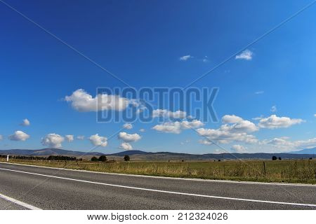 Long open road through beautiful countryside view/ travel landscape nature photography