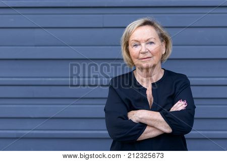 Confident Trendy Senior Lady In A Stylish Outfit