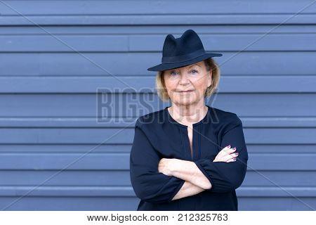 Confident Trendy Senior Lady In A Stylish Hat