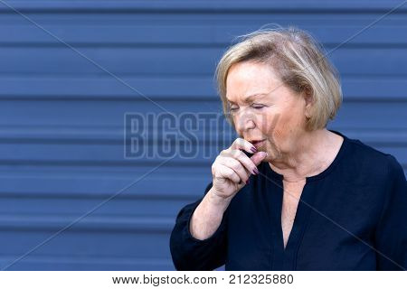 Unwell Elderly Lady Having A Coughing Fit