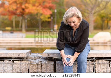 Elderly Lady Grabbing Her Knee In Pain