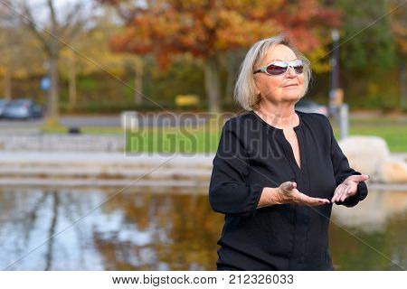 Relaxed Senior Woman Enjoying A Day In Nature