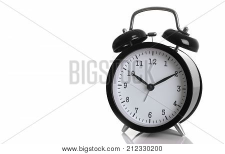 Black alarm clock isolated on white backgroundshows ten hours ten minutes of the morning time to get up to wake up and have breakfast morning or evening jog to go to work.