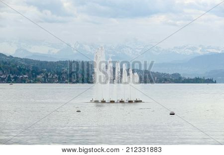 riparian scenery with water fountain at Lake Zurich in Switzerland