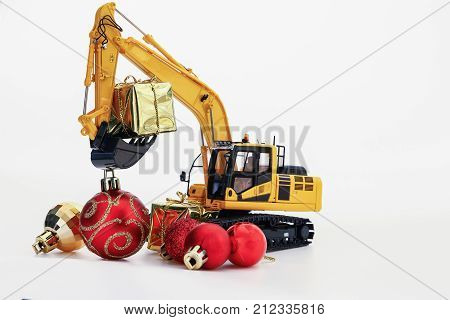 Christmas gift with Excavator model Holiday celebration concept new year on white background