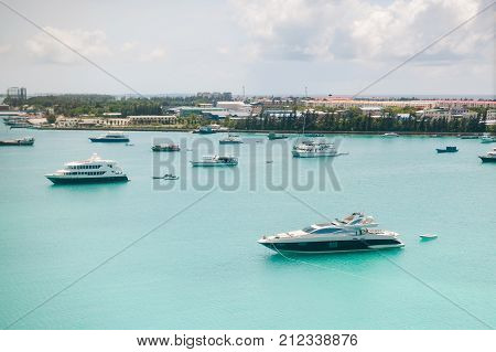 Tropical Islands And Atolls In Maldives In Indian Ocean From Aerial View. Boats On The Water. Piece