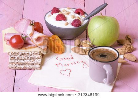 Message wrote on a napkin - Healthy breakfast and a small cup of coffee on a white napkin with the message