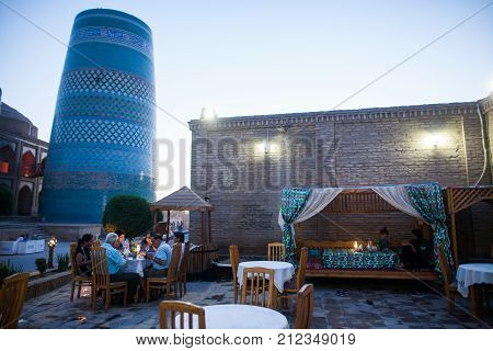 Khiva Uzbekistan - June 2 2017: Detail Of Kalta Minor Minaret In Khiva Uzbekistan With Some Tourists