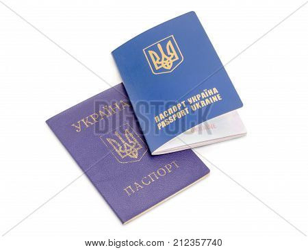 Ukrainian internal passport soft booklet and international passport on a white background
