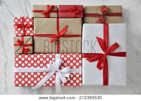 Close up Top view of Brown white and Red gift boxes on white marble background for Christmas and New year.