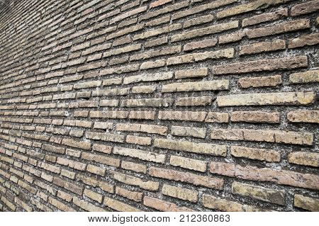 Brown brick wall texture dark background for design .