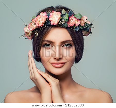 Beautiful Spa Model Woman with Healthy Skin. Spa Girl Smiling on Blue Background. Spa Beauty Facial Treatment and Cosmetology