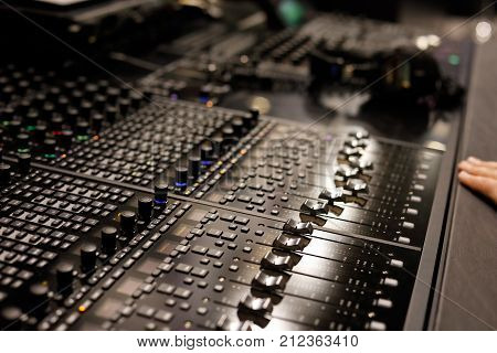 Studio mixing control surface allows controlling the digital audio workstations (DAW). Selective focus.