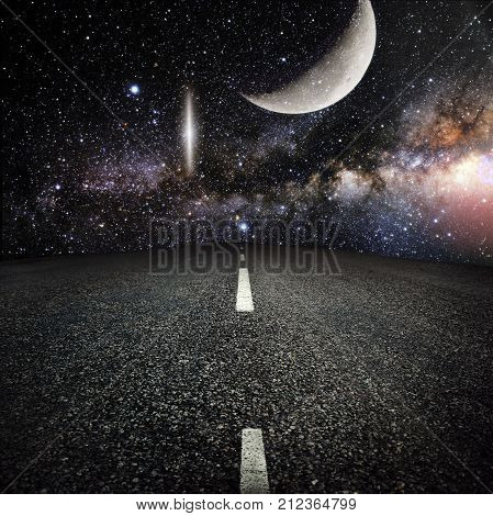 asphalted highway over night sky with stars background. Elements of this image furnished by NASA