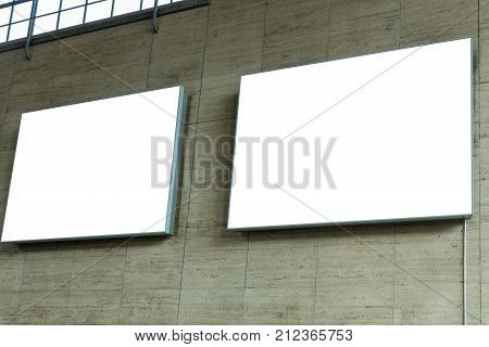 Two Blank Ad Space Signs On Stone Wall