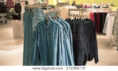Men's clothing store , jeans on hangers
