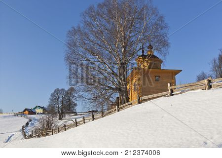 Landscape north village in winter. Village Markovskaya, Verkhovazhsky District, Vologda Region, Russia