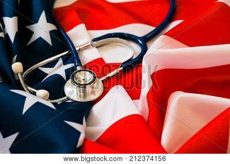Close-up Photo Of Stethoscope On American Flag. Medicine Usa
