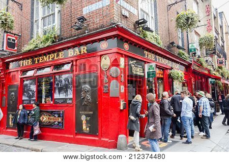 DUBLIN, IRELAND - 05 MAY, 2016: Tourists walking in the Temple Bar area. The place is the cultural quarter in the center of the city and is full of restaurants bars and nightclubs.