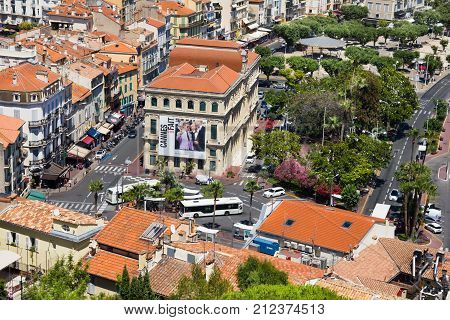 CANNES, FRANCE - June 28, 2016: View of the bus station and the old port of Cannes. The city is famous by the Film Festival, the good weather of the Cot d'Azur and the beautiful landscape.
