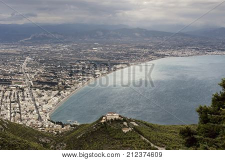 View of the Corinthian Gulf, the city of Loutraki (a resort with mineral springs) and the sea from a height on a cloudy day (Greece, Peloponnese)