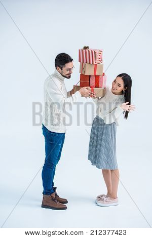 Multicultural Couple Holding Christmas Gifts