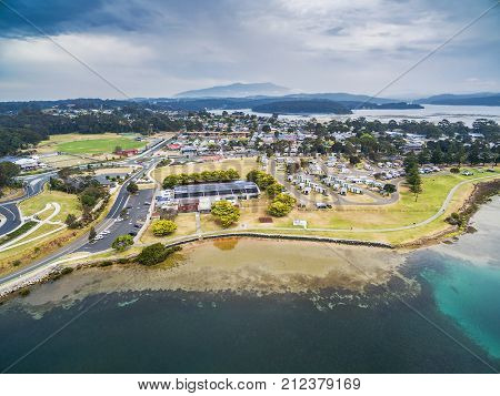 Aerial view of Narooma residential area and holiday park. NSW Australia
