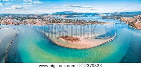 Aerial panorama of shallow ocean water and coastline. Narooma NSW Australia