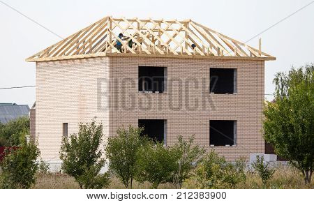 roof construction with wooden beams in the cottage .