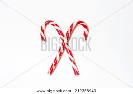 Two Christmas candy canes isolated on a white background