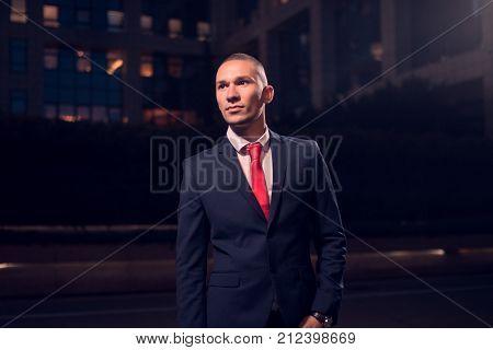 One Young Adult Man, Businessman, Suit, Formal Wear, Outdoors, Night Evening Dark Portrait Modern Bu