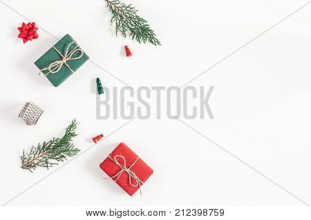 Christmas composition. Frame made of christmas gifts pine branches toys on white background. Flat lay top view copy space
