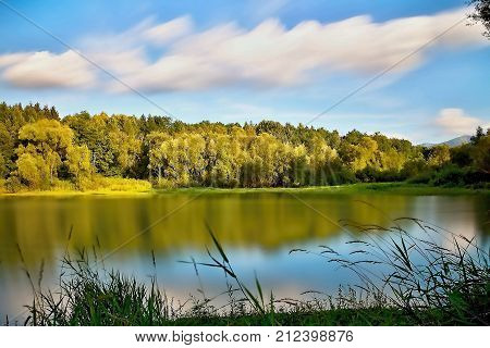 Beautiful bay to the Liptovska Mara dam with the mirroring of the trees on the water surface. Trees mirroring on the water level. Summer scenery in Slovakia. A long time.