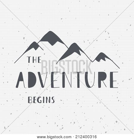 The adventure begins. Handwritten lettering phrase with mountains silhouette. Outdoor and travel concept. Vector illustrations for t-shirts prints posters and cards design.