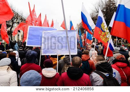 Orel, Russia, November 4, 2017: Unity Day Demonstration. People With Russian And Communist Flags And