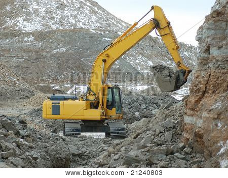 Digger in open pit