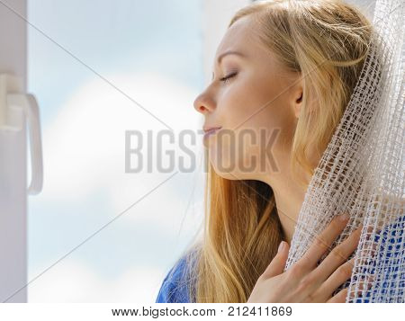 Woman Relaxing On Windowsill